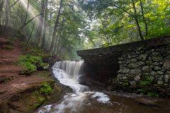 Sunbeams over Waterfall
