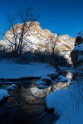 Escalante River Reflecting Sandstone Mountains