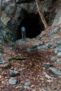 Hiker Standing at Mouth of Tunnel