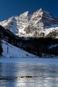 Maroon Bells Over Frozen Lake