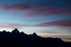 Silhouetted Teton Mountains Below a Twilight Sky
