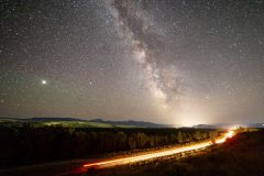 Cars Driving Below Milky Way