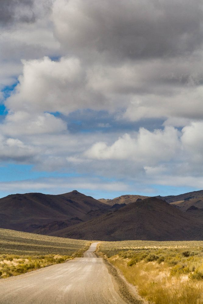 Dirt Road Ascending Into Mountains