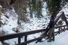 Hiker Admiring Fish Creek Falls