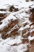 Snow and Ice on Sandstone Wall