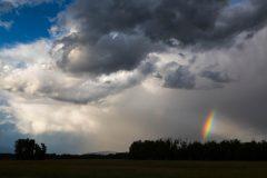 Rainbow Below Storms over Ranch