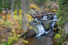 Cascading Waterfalls in Autumn Leaves